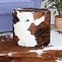 Puffs  e almofadas de  couro ou pele com pêlo