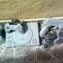 Playstation 1 com pistola e controles