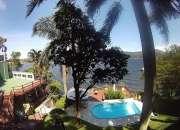 Casa 4 suítes - alto padrão - à beira da Lagoa da Conceição - Floripa/SC